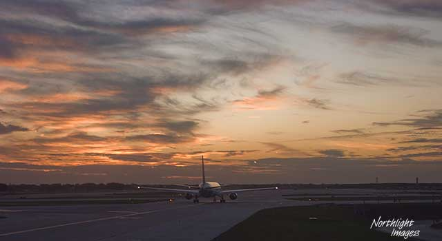 taxing into sunset, Ohare airport chicago