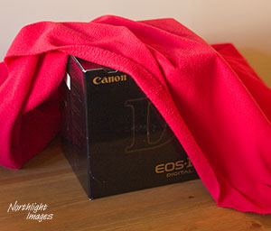 canon box and red sheet