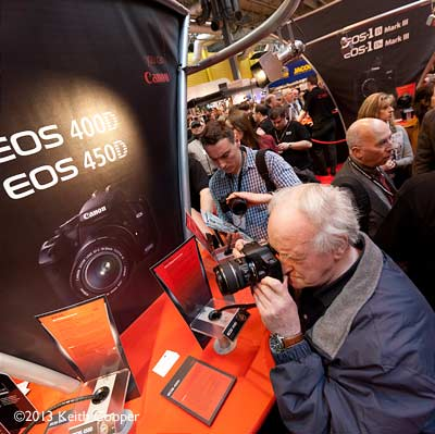 evaluating a new camera at a trade show