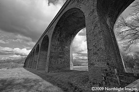 black and white print of viaduct at john o' gaunt