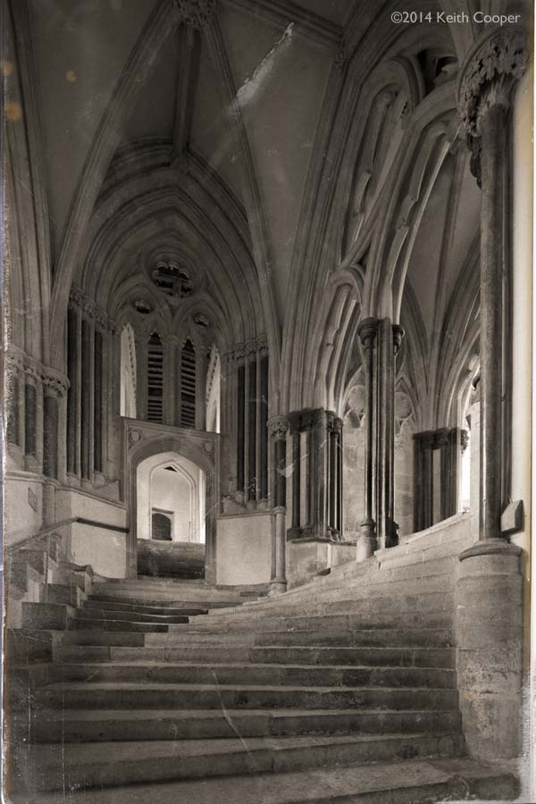 old postcard view of the 'sea of steps' at Wells cathedral