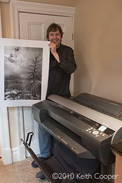 Keith Cooper with large black and white print