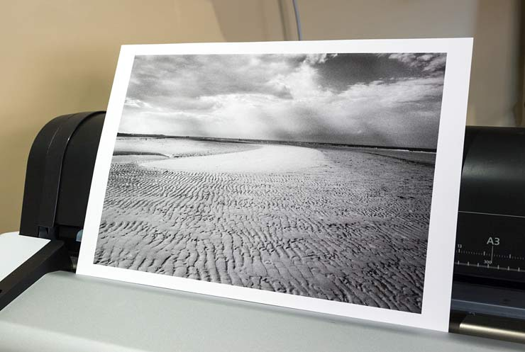 black and white print of Brancaster Bay