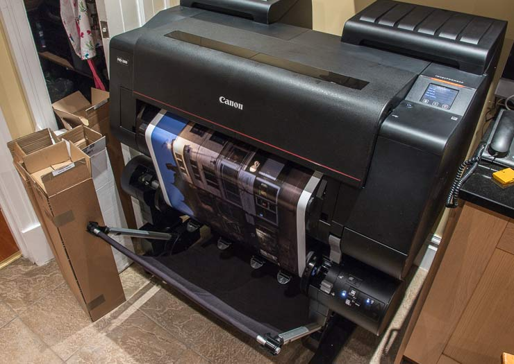 print being spooled on to take-up unit