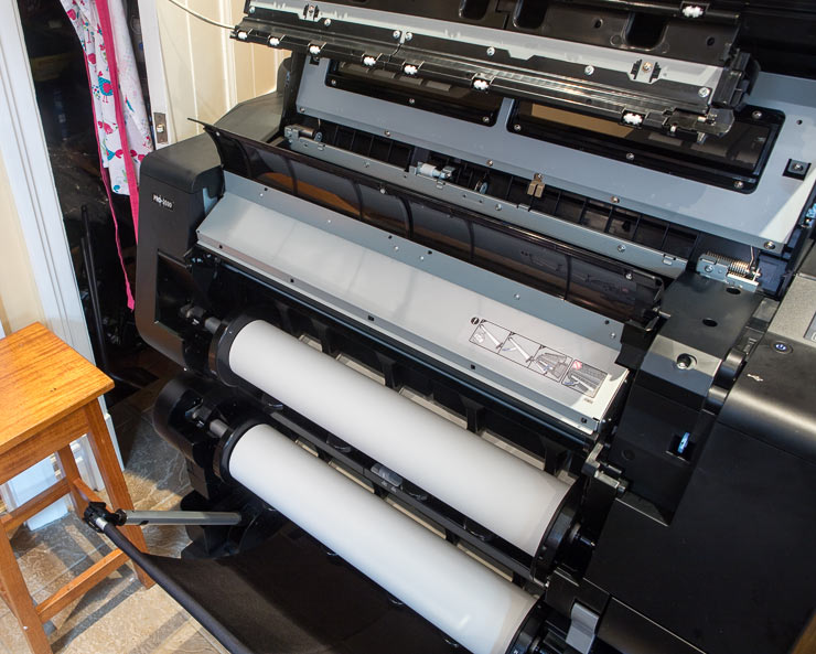two rolls of paper loaded on printer