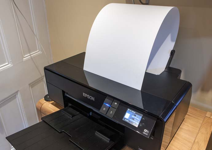 sheet of long paper loaded into printer