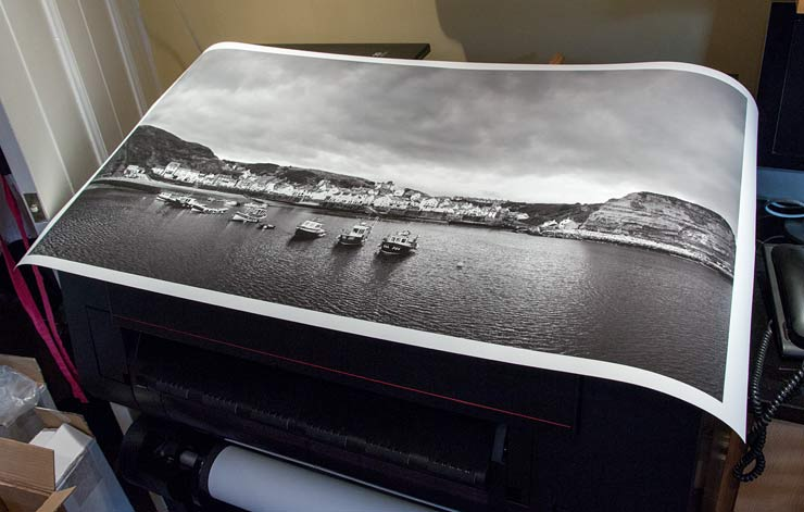 large black and white print of Staithes harbour