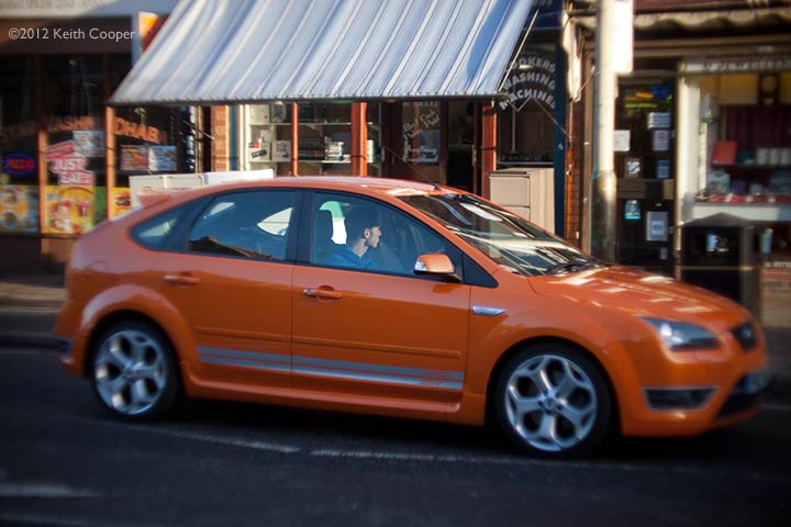 man in orange car