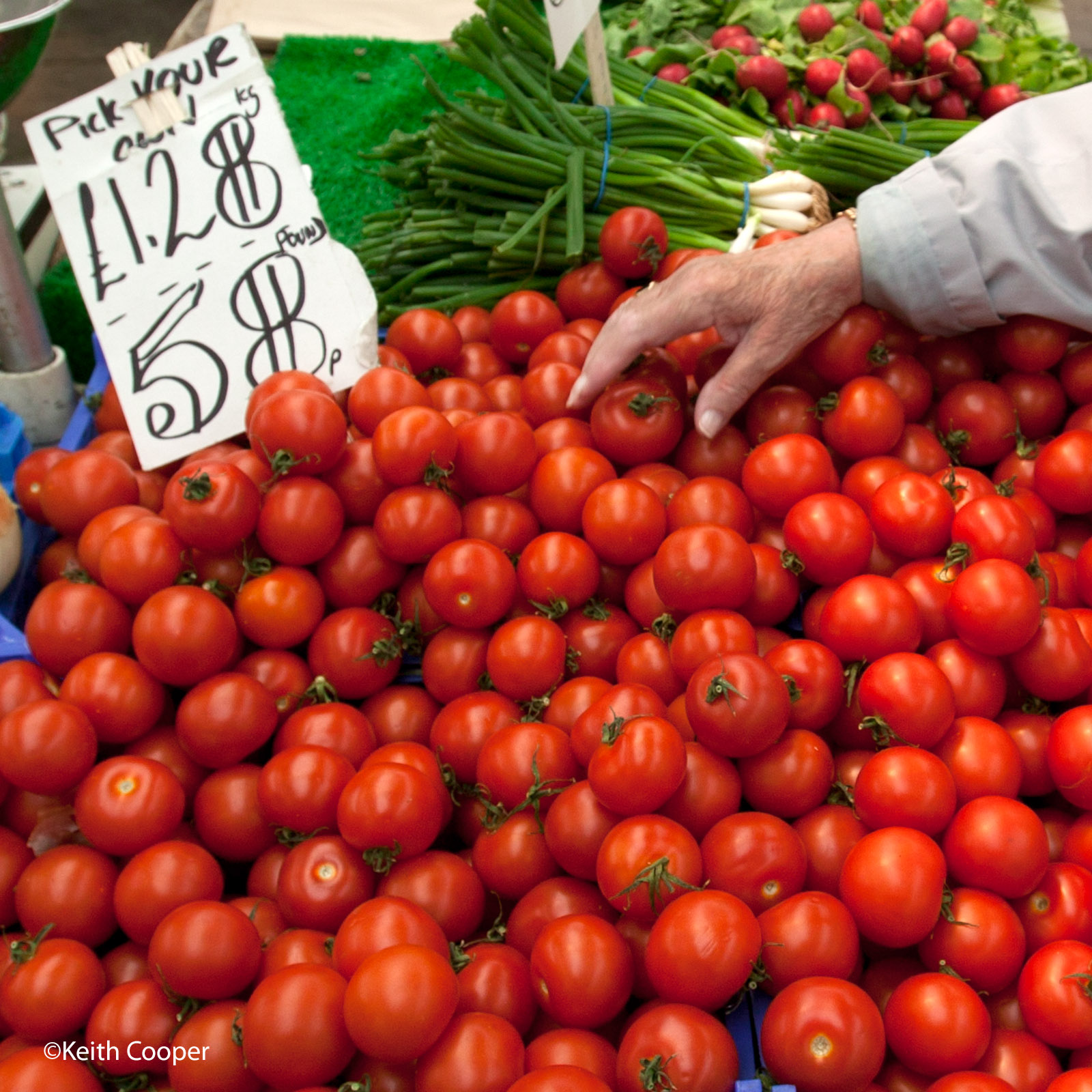 Choosing tomatos at food market