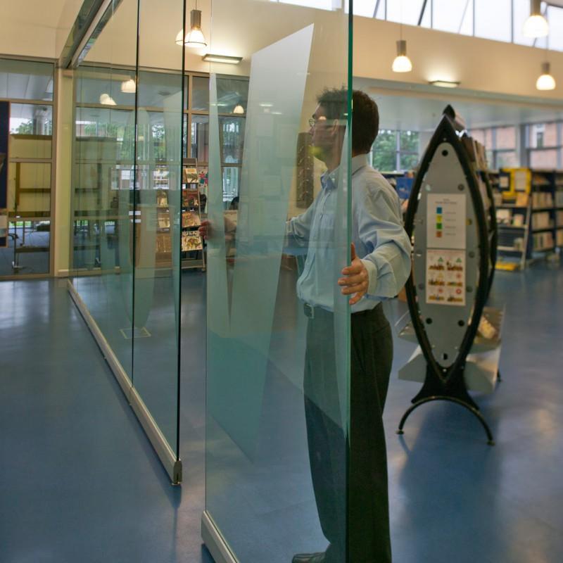 Sliding glass partition doors