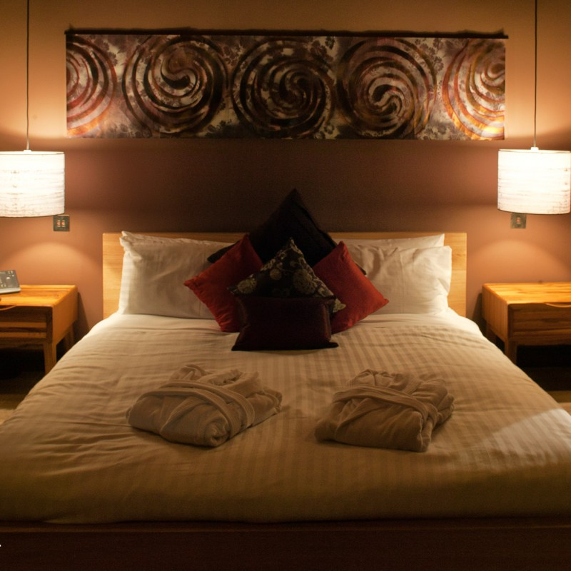 Large double bed in hotel room