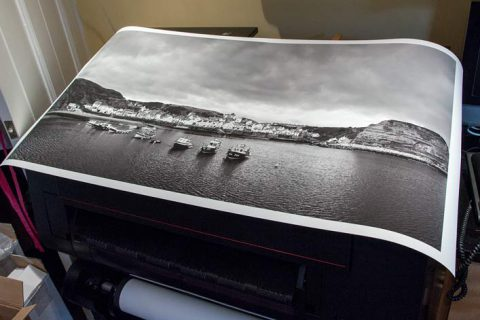 Tutorial: A large black and white print of the harbour at Staithes