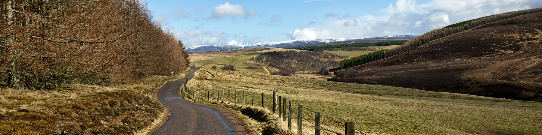 Road in the Highlands heading towards mountains